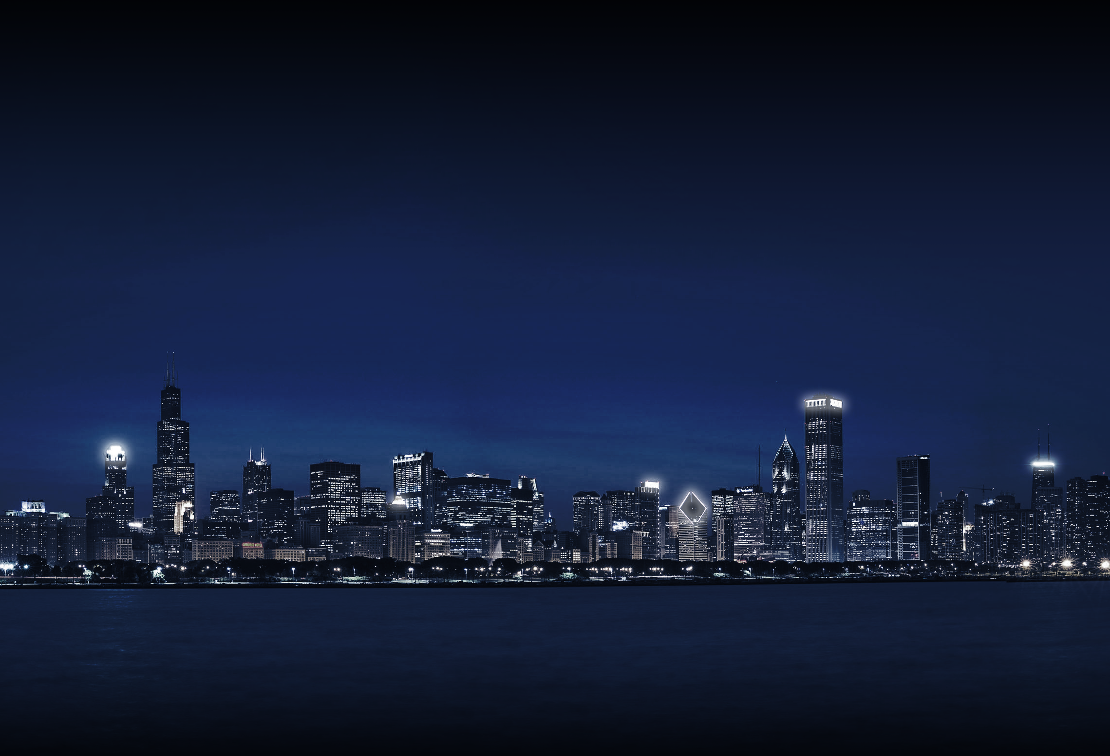 Chicago Illionois city skyline at night with glowing lights